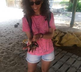 SEP student with baby crocodile on an Island at Ada