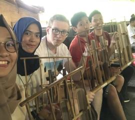 we played the traditional music instrument from Indonesia called Angklung at Saung Udjo, Bandung