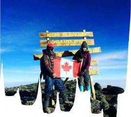 Our SEPer at the top of Mount Kilimanjaro ( 5895metres)